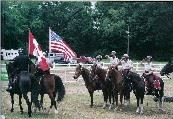 Volunteer officers on horses carrying flags